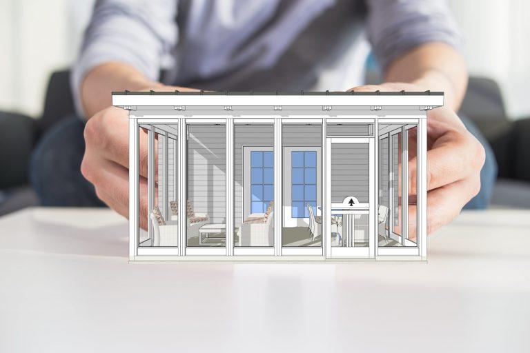 man holding screen porch kit